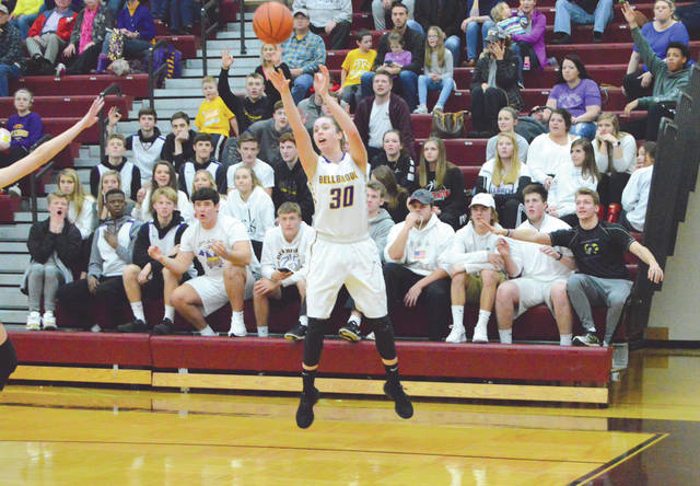 With plenty of support from the Bellbrook student section behind her, Kayla Paul hits a three-point shot in the second half of a Division II sectional second round tournament game against Alter, Feb. 20 at Lebanon High School.
