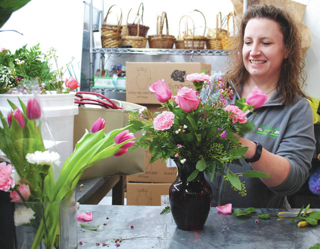 Jocelyn Whitt preparing a Valentine's Day bouquet.