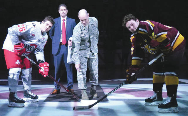 Submitted photo Col. Michael Foutch, 88th Medical Group commander, drops the ceremonial first puck at the Military Appreciation game between the Ohio State Buckeyes and the Minnesota Golden Gophers at the Value City Arena Schottenstein Center in Columbus Feb. 15. The Buckeyes lost the game 3-4.