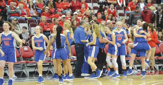 The Carroll High School girls basketball team celebrates after defeating Akron St. Vincent-St. Mary, 57-38, in the Division II state semifinals, March 14 at the Jerome Schottenstein Center in Columbus.