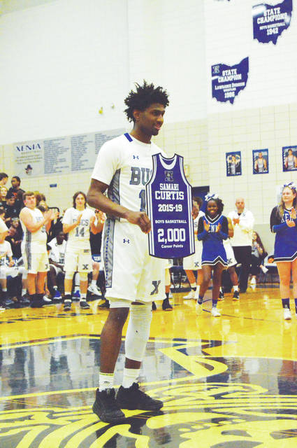Xenia High's Samari Curtis was recognized for surpassing the 2,000-point mark during his high school career on Feb. 14 in the high school's Blue Pit gymnasium. Curtis finished his career with 2,109 points, all at XHS.