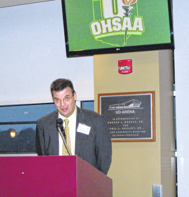 Submitted photos John Bombatch speaks to attendees of the Ohio High School Athletic Association's dinner presenting its annual Media Awards, March 9 at UD Arena in Dayton.