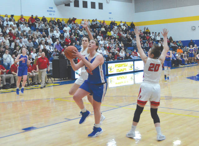 Carroll's Julia Keller splits the Franklin defense for a first-half score, March 8 in the Division II girls high school basketball regional championship game at Springfield High School. Keller led the Patriots with 18 points scored.