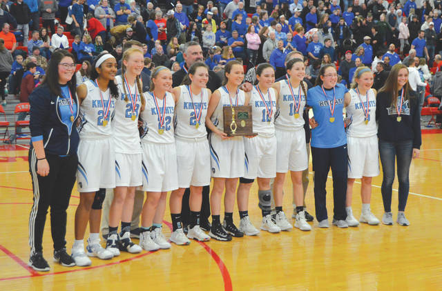The Division IV district champion Legacy Christian Academy Knights girls high school basketball team poses for photos, March 2, after a 49-34 win over Franklin Monroe at Troy High School.