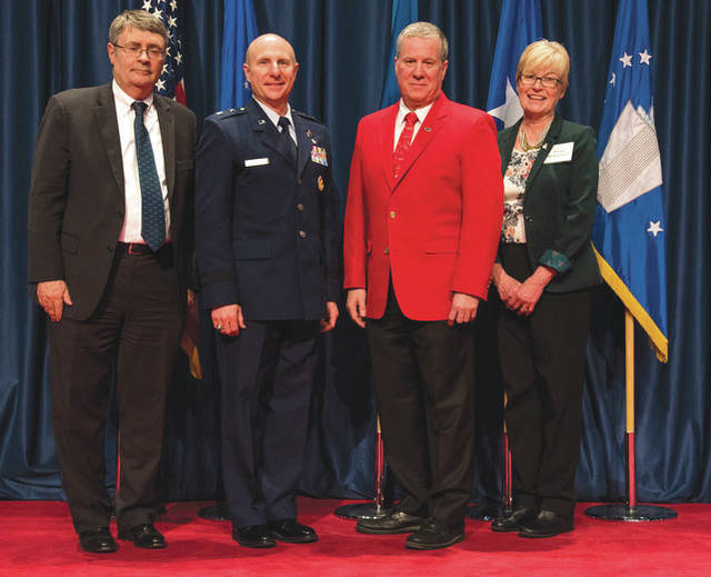 Submitted photo David Hills (red jacket) received the 2018 Director's Award for Volunteer of the Year for his dedication and excellence in serving the National Museum of the U.S. Air Force. (from left to right) Museum Director David Tillotson III, Maj. Gen. Carl E. Schaefer Deputy Commander, Air Force Materiel Command, Volunteer David Hills, and Air Force Museum Foundation Board of Trustees President Col.(Ret.) Susan E. Richardson.