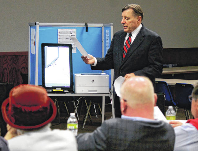 Anna Bolton | Greene County News Dominion Voting Systems Sales Manager Mark Beckstrand shows the ImageCast X to Greene County Board of Elections officials and Board of Commissioners March 6.