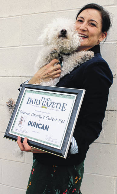 Anna Bolton | Greene County News Duncan, 13, poses with his human, Ann O'Donnell, outside the <em>Gazette </em>office April 11. Greene County voters selected Duncan to be honored as Greene County's Cutest Pet.