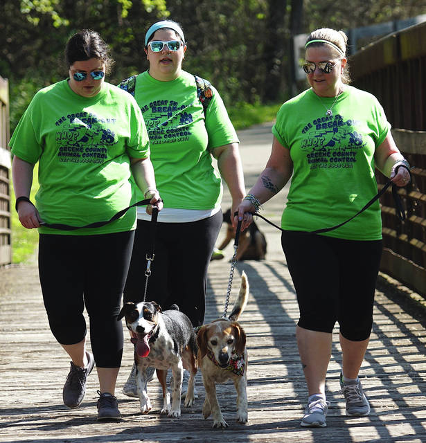 File photo Greene County Animal Care and Control volunteers and adoptable pups walk during the Shelter Break-Out 5K May 12, 2018 on Creekside Trail. This year's GCAC 5K will be held Saturday, May 11.