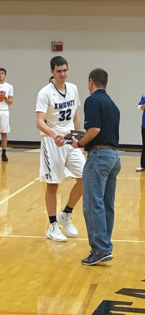 Erik Uszynski receives his Player of the Year award from District 15 administrator and former Fairborn coach Nathan Chivington.