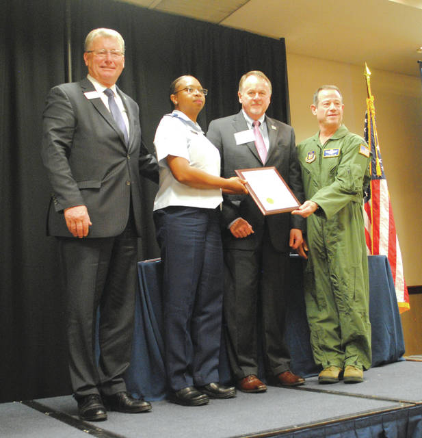 "Whitney Vickers | Greene County News The 445th Airlift Wing of Wright-Patterson Air Force Base earned the ""Air Force Outstanding Unit Award"" which was given based on ""exceptionally meritorious service."" It was also honored as a county achiever during the Greene County Annual Report to the Community."