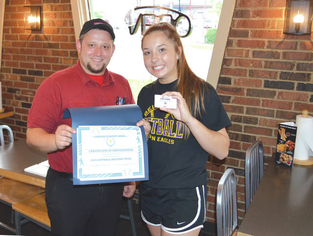 Pizza Hut General Manager Brandon Beatty presents Bellbrook High School's Kaley Clark with a certificate and $50 in Pizza Hut gift cards, May 16, in recognition of her second consecutive Greene County area high school softball batting title. The Xenia Pizza Hut, located at 354 W. Main St., is sponsoring the award for the second straight year.