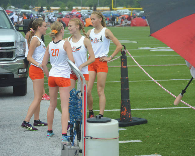 The Beavercreek girls 3,200-meter relay team of (left-to-right) Juliann Williams, Savannah Roark, Jodie Pierce and Taylor Ewert smashed the previous regional meet record in Wednesday's final at Heidkamp Stadium at Huber Heights Wayne High School. Beavercreek beat the previous mark by more than 10 seconds.
