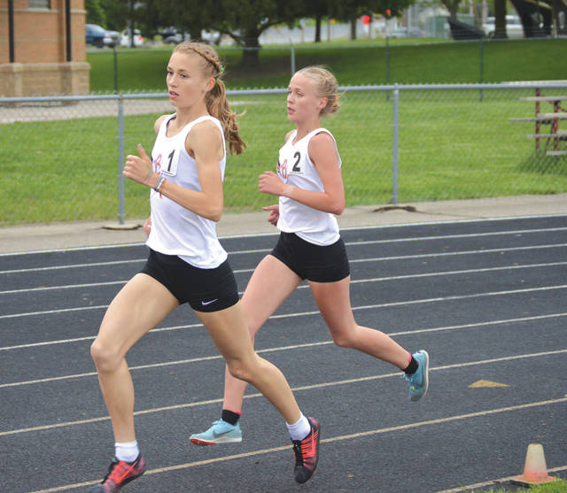 Juniors Taylor Ewert and Savannah Roark, of Beavercreek, each eclipsed the previous meet record to finish 1-2 in the girls 3,200-meter run, May 10 in Troy. The Beavercreek girls team took home the National Conference team title as well.