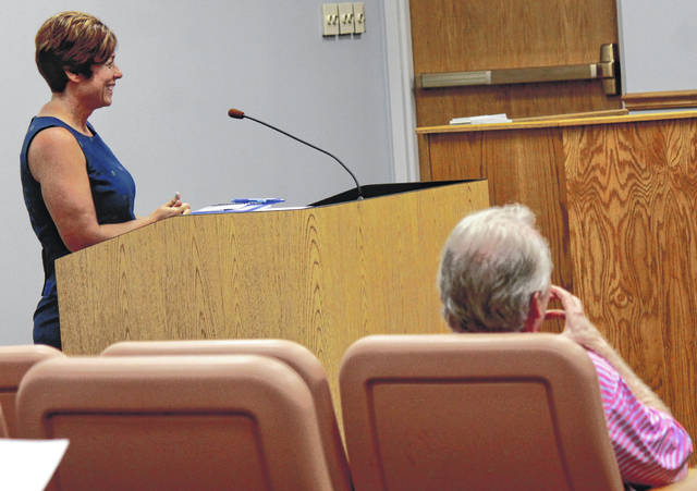 Stephanie Goff, chief deputy in the Greene County Engineer's Office, speaks at the Greene County Board of Commissioners meeting May 16 as County Engineer Bob Geyer listens.