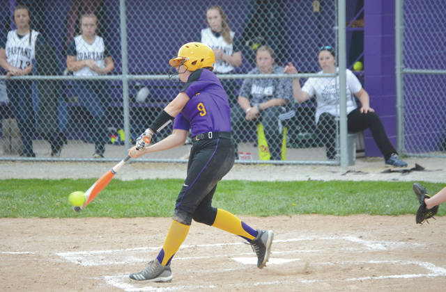 Bellbrook High junior Kaley Clark muscles an inside pitch into center field for a two-run single in the first inning of Tuesday's Division II sectional tournament softball game against visiting Valley View.