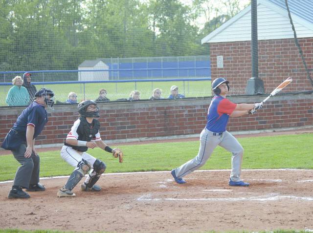Greeenview's Tommy Rawlins watches his game tying sacrifice fly take off for right field, in the sixth inning of Monday's Division III district semifinal game at Brookville High School.