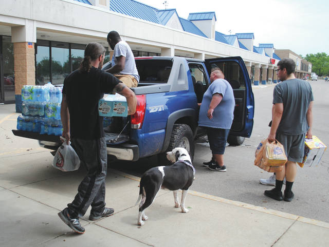 Whitney Vickers | Greene County News  The Xenia Boys, along with members of Snap Fitness in Xenia, loading up donated supplies. Snap Fitness is continuing to take donations and is opening its doors to members of LA Fitness in Beavercreek until its electricity is restored.