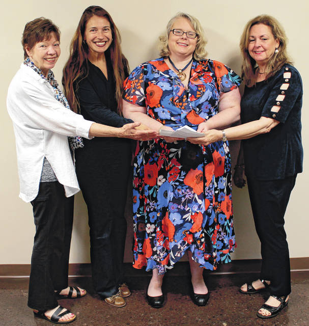 Anna Bolton | Greene County News Sandy McHugh, 100 Women founder; Debbie Matheson, Family Violence Prevention Center executive director; Cherie Dixon, FVPC prevention coordinator and Rebecca Morgann, 100 Women founder, gather for the $11,800 check presentation June 7 at the center.