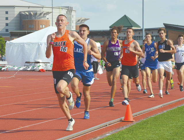 Beavercreek senior Riley Buchholz takes off from the pack in the late stages of the Division I boys 1,600-meter run, June 1 at Ohio State University's Jesse Owens Memorial Stadium, in Columbus.