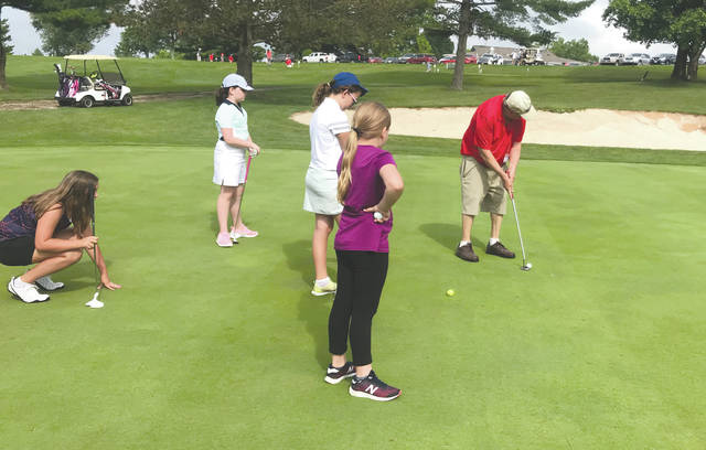 A group of junior golfers practice on the WGC Golf Course putting green, during the 33rd annual Miami Valley Junior Golf Association youth golf camp, held earlier this month in Xenia.
