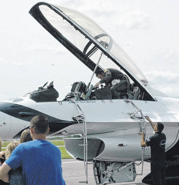 Xenia firefighter/paramedic Levi Dalton climbs out of a U.S. Air Force Thunderbirds F-16 at the Dayton Air Show Friday.