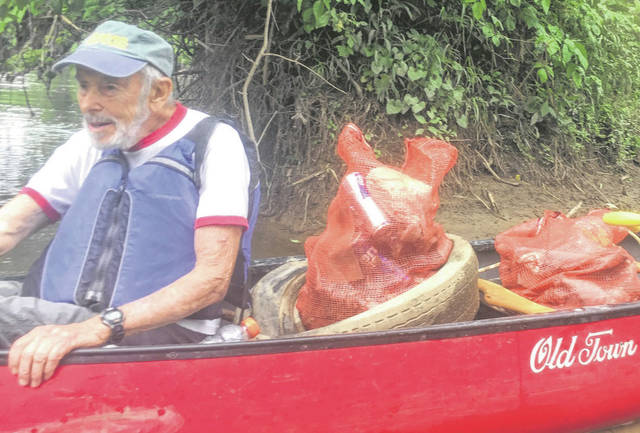 Mike Freemont, who was part of the first river clean in 1971, has a boat full of trash.