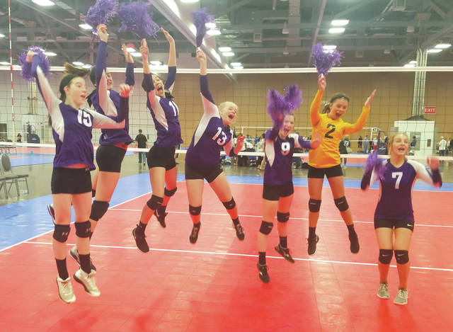Members of the Club Magic U13 girls volleyball team celebrate after winning the Girls 13 Titanium regional title at the Ohio Valley Region Sports Imports Girls Junior Championships, held May 18 at the Greater Columbus Convention Center.