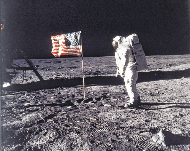 FILE - In this image provided by NASA, astronaut Buzz Aldrin poses for a photograph beside the U.S. flag deployed on the moon during the Apollo 11 mission on July 20, 1969. Television is marking the 50th anniversary of the July 20, 1969, moon landing with a variety of specials about NASA's Apollo 11 mission.