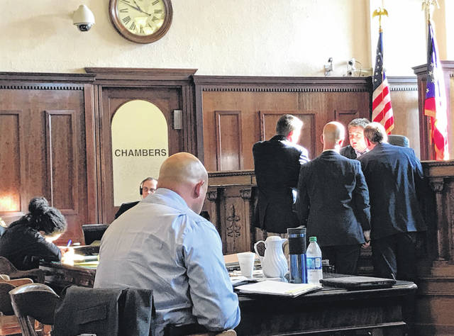 Anna Bolton | Greene County News Defendant Kali Christon, far left, takes notes as Assistant Prosecutor David Hayes, Defense Attorney Griff Nowicki and Assistant Prosecutor Bill Morrison speak with Judge Michael Buckwalter.