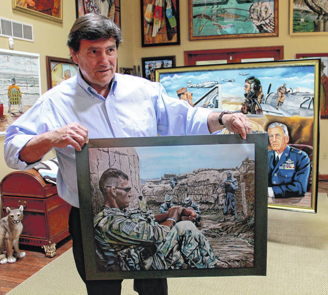 Xenia artist Gary Blevins holds up a print of another portrait he did of a tired Sgt. Scott Bass, the pilot's grandson who served two Army tours in Afghanistan.