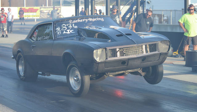 The back wheels of Randy Zachery's Camaro dig into the pavement during a Test & Tune session July 25 at Kil-Kare Dragway in Xenia Township.