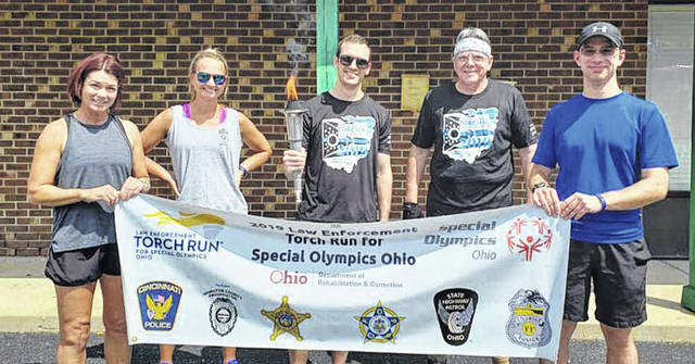 Detective Holly Clay, Officer Allie Mumpower and Officer Ryan Linnell represented Xenia Police Division in the Ohio Special Olympics Torch Run June 27. Retired XPD Officer David Greene and Cedarville Police Department Officer Andrew Hull also participated in the Torch Run.