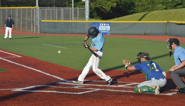 Xenia Scouts infielder Brett Williams fights off an inside pitch for the team's first hit of the evening, July 11 at Grady's Field on the Athletes In Action Sports Complex. Xenia won its third straight game, this time by a 4-3 tally, over the Cincinnati Steam.