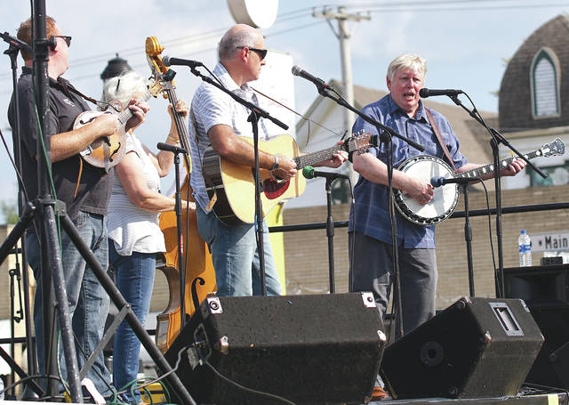 File photos The 3rd Annual Bluegrass and Brews is slated for 4-10:30 p.m. Saturday, Aug. 2 along Main Street in Fairborn. Pictured is previous performer Mark Whitt and True Bluegrass.