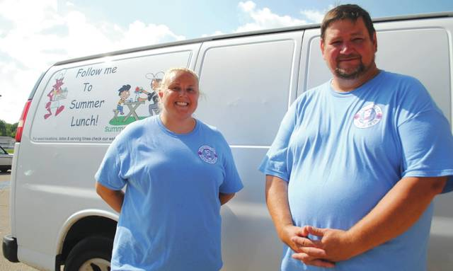 Whitney Vickers | Greene County News Christina Wilcox-Reigel and Jeff Greer prepare and serve the food for the Fairborn City Schools Summer Lunch Program.
