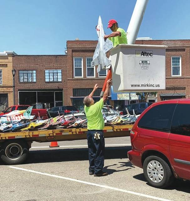 Submitted photos The City of Fairborn annually hangs small plane replicas along Main Street through the summer months. Merchants and individuals can choose to purchase a plane and then decorate it to their choosing.