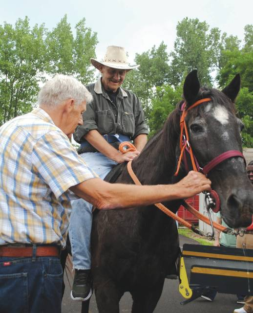Whitney Vickers | Greene County News One of the items on Rex Musick's (right) bucket list was to ride a horse one last time. His wish was fulfilled July 19 thanks to staff at Wright Rehabilitation and Nursing and Jimmy (pictured on the left) and Linda Williams, who own the horse, named Buckwheat, in Springfield.