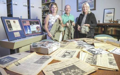 Submitted photo Sue Polanka, left, university librarian; Bill Stolz, reference and outreach archivist; and Dawne Dewey, head of Special Collections and Archives, with some of the archives' materials related to the Apollo 11 mission.