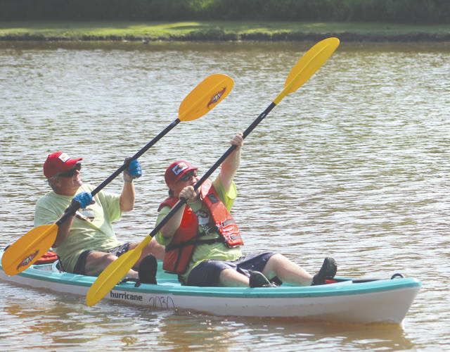 Mike and Dylan Chard of Beavercreek celebrate after winning the Men's Open K-2 5-mile title at the Ohio Canoeing, Kayaking and Paddleboarding Championships, July 27, in Fairport Harbor.