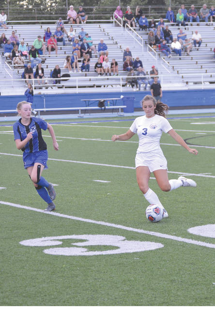 Greeneview junior midfielder Alexa Simpson gets off a pass as a Xenia defender closes in, during second half action at Doug Adams Stadium in Xenia. Greeneview won the game, 2-0.