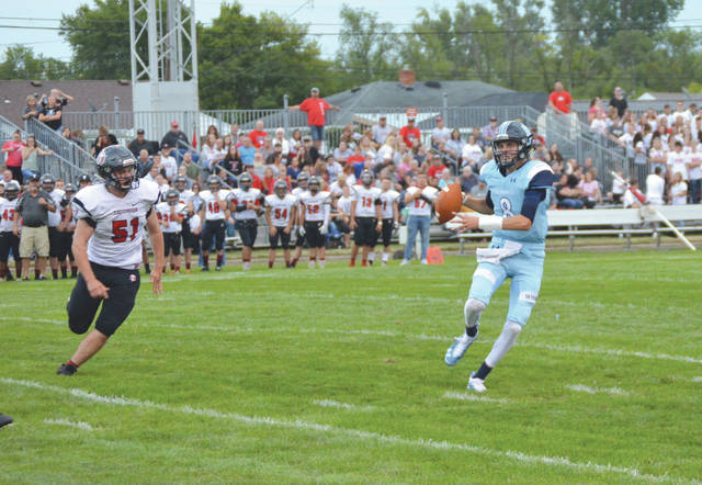 Fairborn quarterback Garison Secrest looks to throw downfield during the first half of Friday's high school football game with visiting Tecumseh, at Fairborn Memorial Stadium.