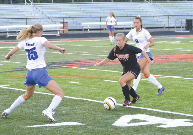 Senior Sarah Huffman (5) drives between a pair of Anthony Wayne defenders during the first half, Aug. 6, of Beavercreek's first girls high school soccer scrimmage game of the 2019 season. Beavercreek won the Division I state title last season.