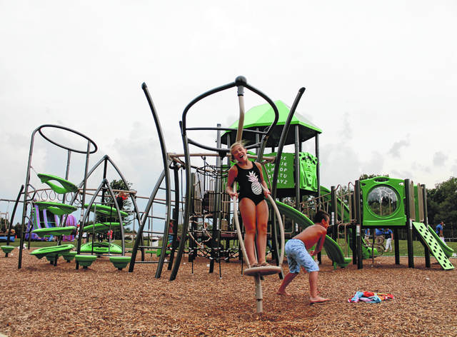 Anna Bolton | Greene County News Kids take turns spinning each other at the new playground located at Greene County Parks & Trails' Fairgrounds Recreation Center in Xenia Aug. 20.