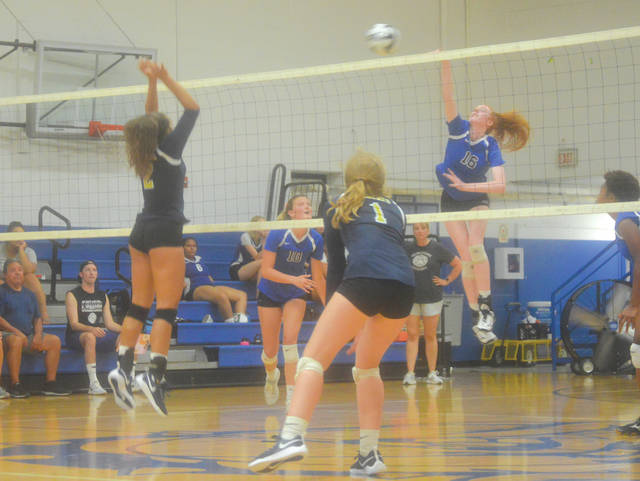 Yellow Springs' hard hitting combo of Emma Ronnebaum (16) and Tyler Linkhart (10) both had big days in Monday's five-set win over visiting Springfield.