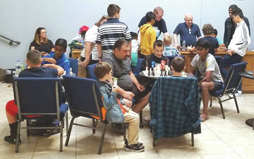 Chess players participating in the tournament as the event was getting started.