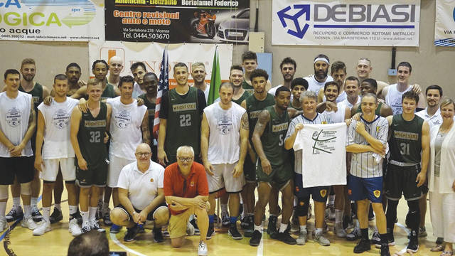 Players, coaches, staff and officials from an exhibition basketball game between Wright State University and Vicenza Locali gather for a group photo, Aug. 9 in Vicenza, Italy.
