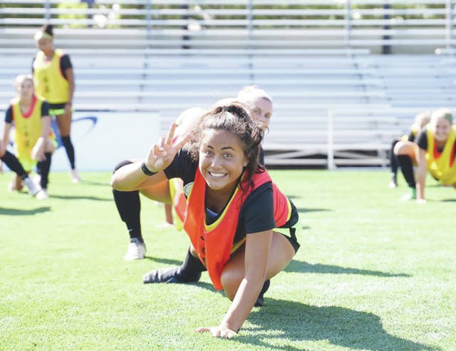 Diana Benigno of Beavercreek has fun with a photographer during a recent national select camp July 22-27 in Portland, Oregon.