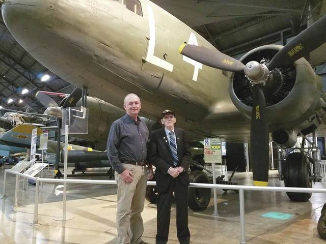 "Submitted photo Air Force Research Laboratory Aerospace Systems Directorate employee Kevin Price (left) and World War II veteran Jim ""Pee Wee"" Martin look over the C-47 aircraft displayed at the National Museum of the United States Air Force."