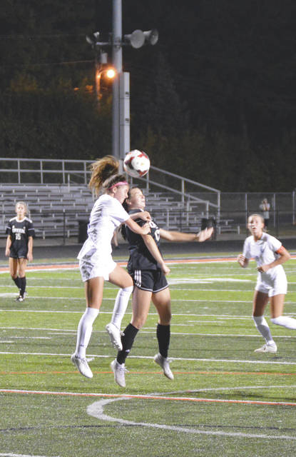 Beavercreek junior forward Kesley Louderback (17) and Springboro's Lily Downs (14) collide while heading the ball, during the first half of Wednesday's Greater Western Ohio Conference girls soccer match at Frank Zink Field in Beavercreek.