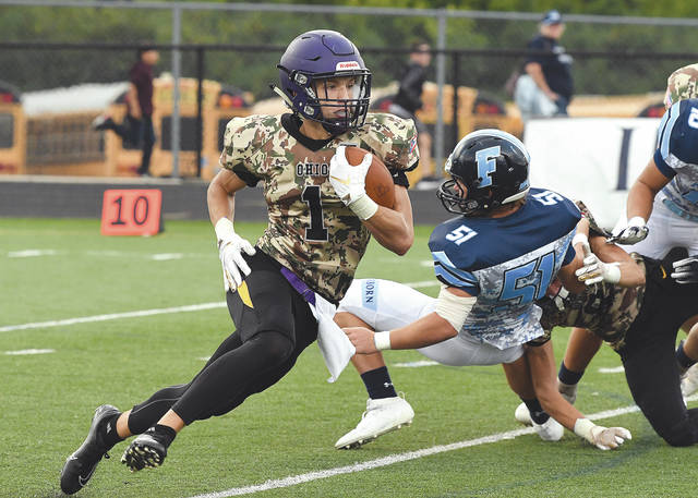 Bellbrook sophomore running back Seth Borondy (1) breaks for a long gain during the first half of Friday's game against Fairborn.